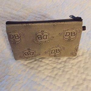 Dooney & Bourke cosmetic bag.